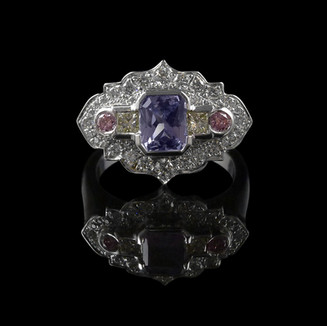 Engagement ring: Handmade 18 carat white gold engagement ring with an unheated Ceylon sapphire centre stone, and yellow, pink, and white diamonds.