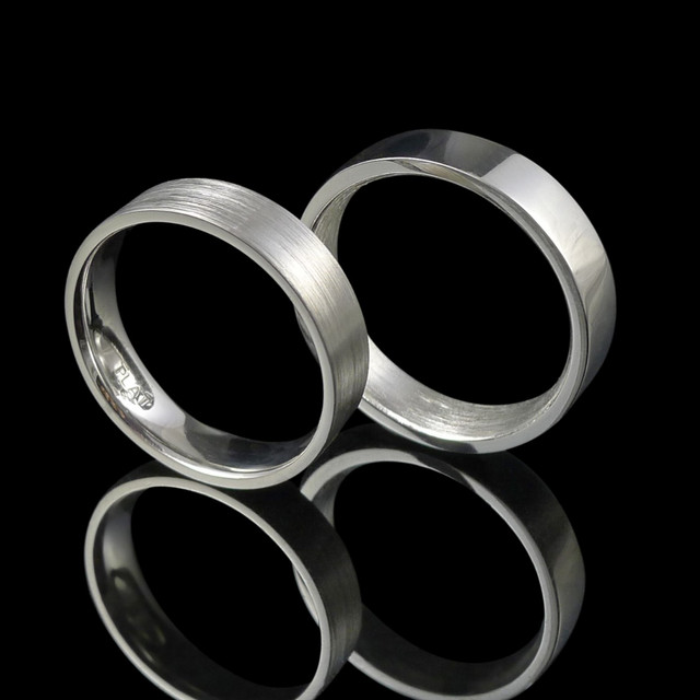 Handmade platinum wedding rings with opposite internal and external finish.