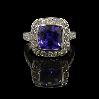 Engagement ring: Handmade engagement ring in 18 carat white gold, wtih a cushion cut Ceylon sapphire and diamonds.