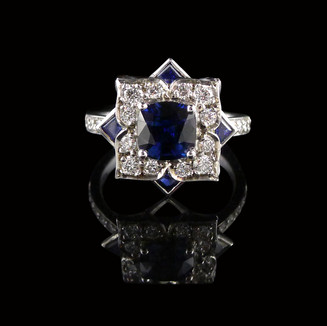 Engagement ring: Handmade white gold engagment ring, with a cushion-cut Australian blue sapphire centre stone, triangle sapphires, and diamonds.