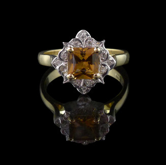 Engagement ring: Handmade engagement ring in 18 carat yellow and white gold with a copper-coloured sapphire and diamonds.