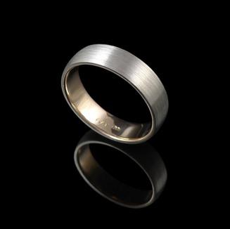 Handmade wedding ring in 18ct yellow gold and platinum.