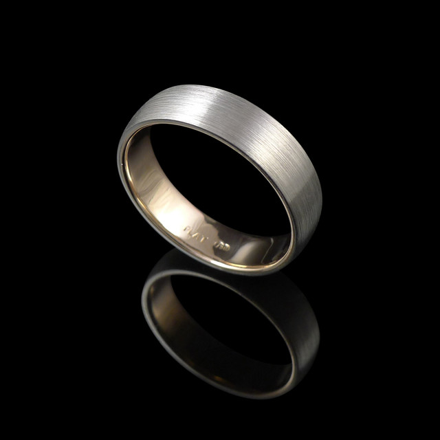 Handmade wedding ring in 18ct yellow gold and platinum.