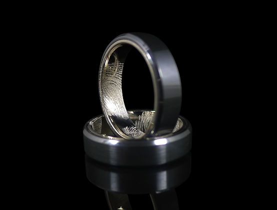 Custom designed black zirconium and 18ct