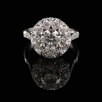 Engagement ring: 18 carat white gold and diamond engagement ring.