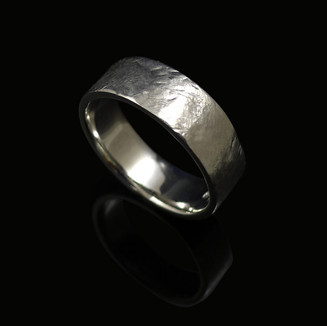 Handmade wedding ring in 18ct white gold, with a beaten texture finish.