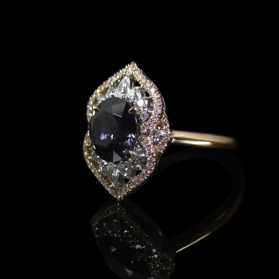 Engagement ring: In 18ct rose gold and white gold, featuring a grey spinel centre and diamonds.
