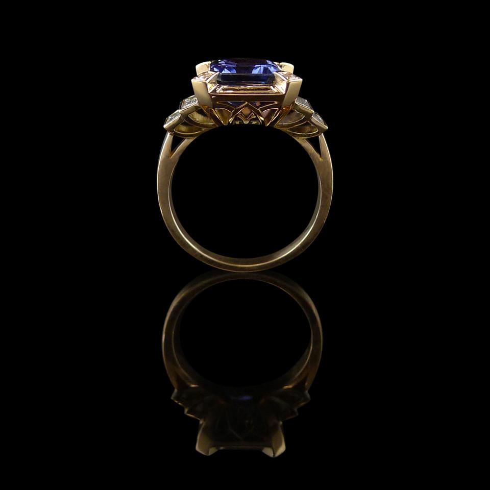 Engagement ring: Rose gold, tanzanite, and diamond engagement ring.