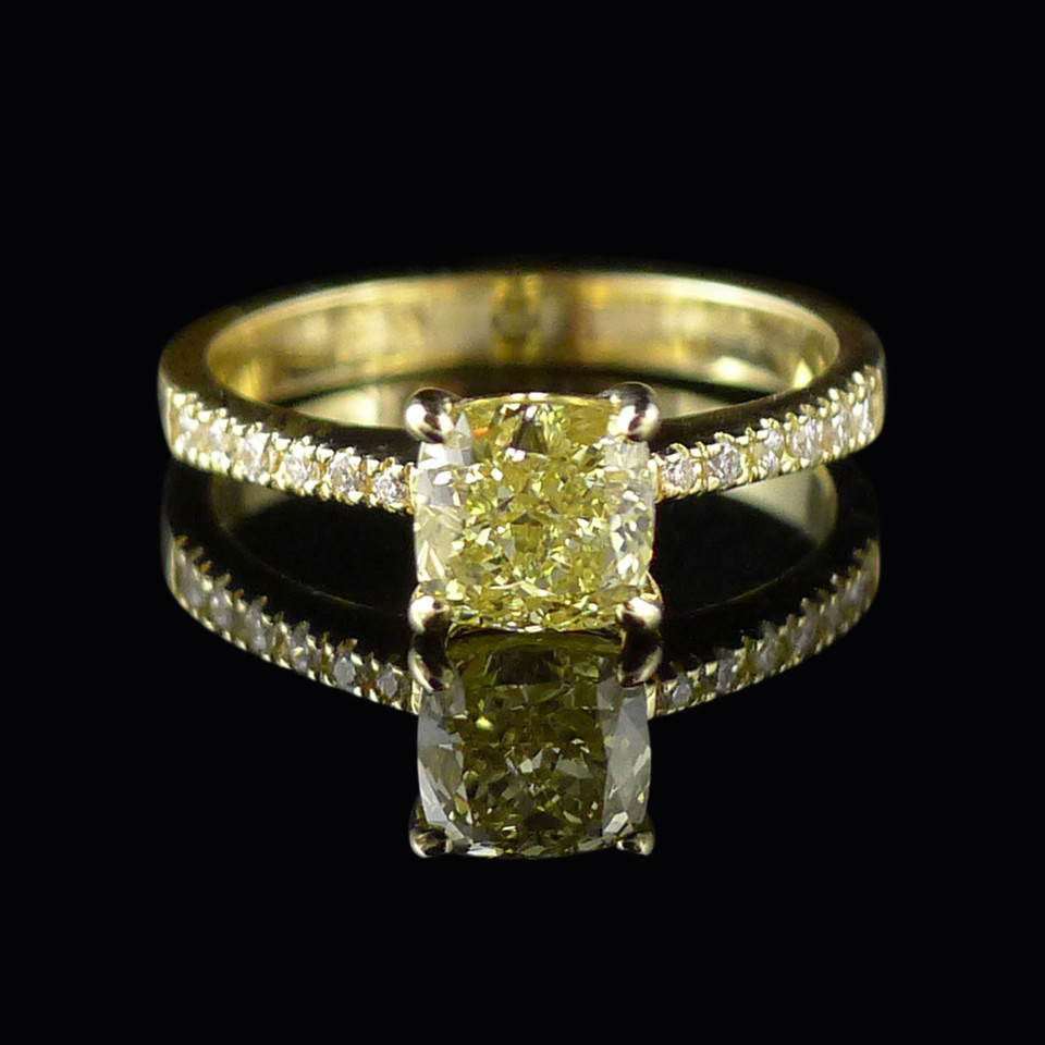 Engagement ring: Handmade engagement ring in 18 carat yellow gold, with a cushion cut natural fancy yellow diamond.