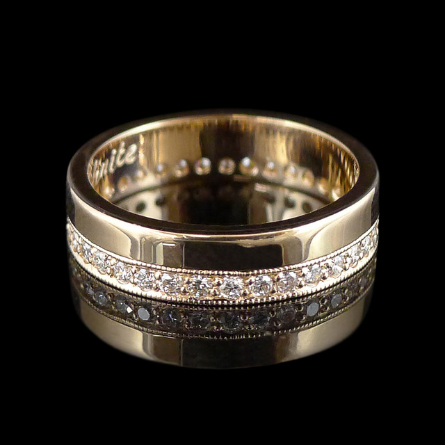 18ct yellow gold custom wedding ring with diamonds and hand engraving.