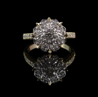 Engagement ring: 18 carat yellow and white gold, geometric engagement ring with diamonds.