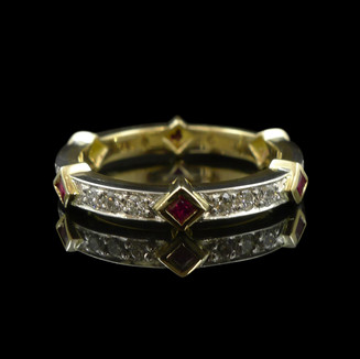 Handmade wedding ring in 18ct yellow gold and 18ct white gold, with diamonds and rubies.