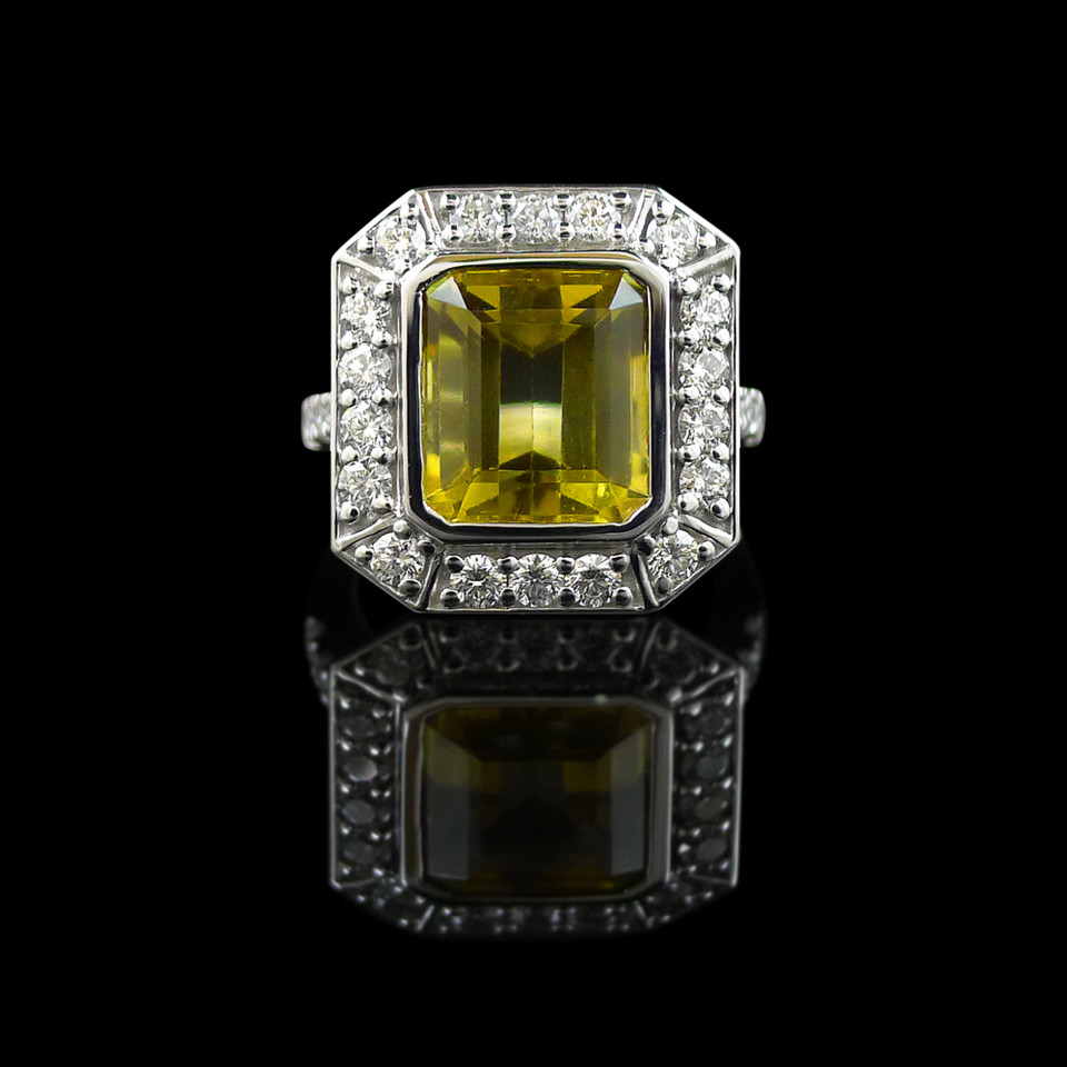 Engagement ring: Art Deco inspired ring, in 18 carat white gold, featuring an emerald-cut citrine and diamonds.