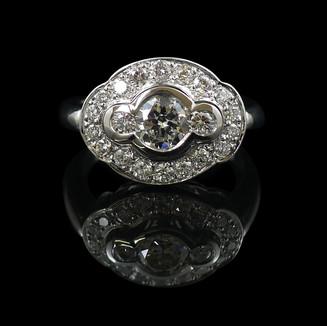 Engagement ring: Handmade 18 carat white gold engagement ring with diamonds.