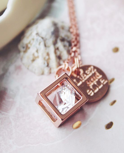 Caged Diamond in rose gold necklace