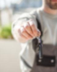 Service deptartment technician handing you keys