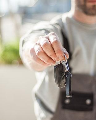 Service depatment technician handing you keys