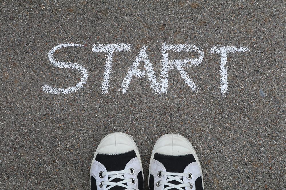 Start written in chalk on pavement