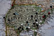 Map of the United States with pins on the east and west coast