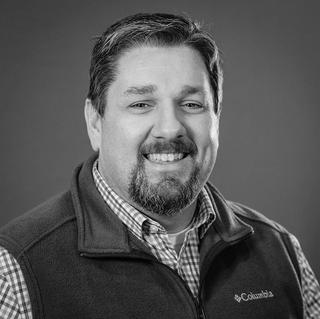 Chris M. Moore, Chief Storyteller & Partner
