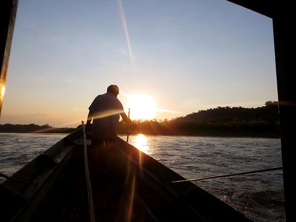 Boat riding during sunset Madidi Tuichi river