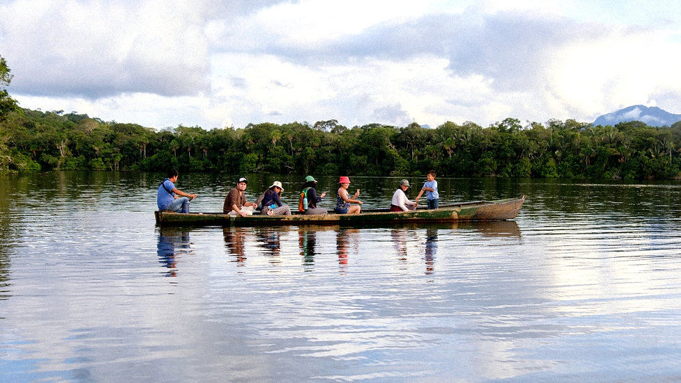 Tourists sailing across Santa Rosa lagoon in Madidi with Yuruma Journeys