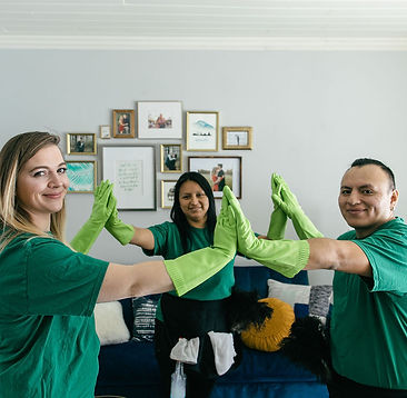 Three Right Touch cleaning technicians giving high-fives to show team spirit.
