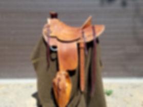 Roughout custom saddle with tapaderos
