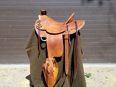 Roughout custom saddle with tapaderos