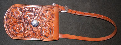 Carved leather purse