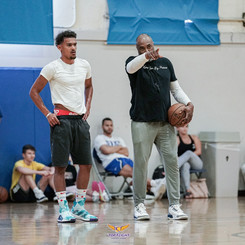 Trae Young with one of the LA experience coaches
