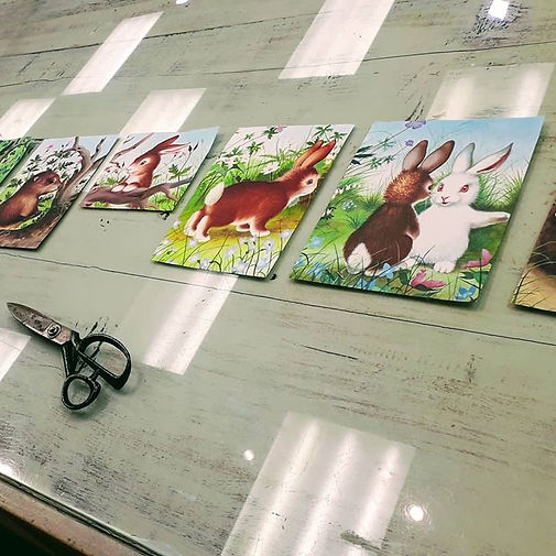Book pages of bunnies laid out on a table to make a bunting