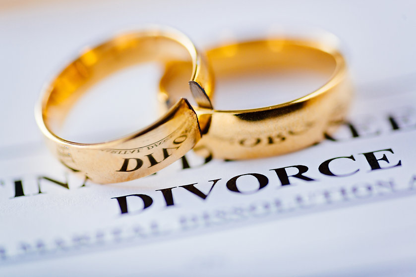 Two broken golden wedding rings divorce