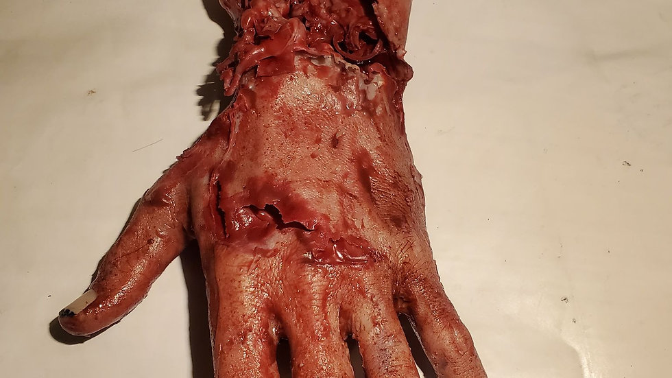 Male hand with skinned arm movie prop