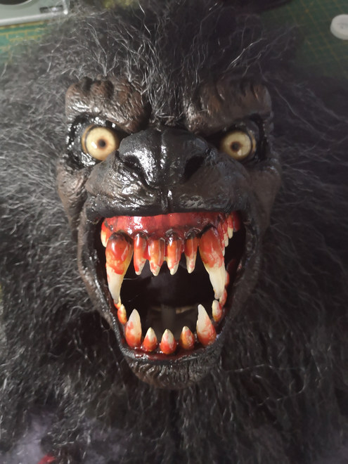 Werewolf mask with moving jaw and snarling lip lifter