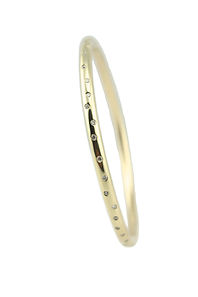 18CT YELLOW GOLD AND DIAMOND BANGLE. LIKE THE NIGHTS SKY WRAPED ARROUND YOUR WRIST