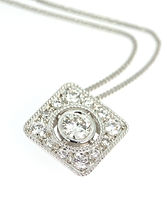 PLATINUM AND DIAMOND PAVE SET FLOATING PENDENT