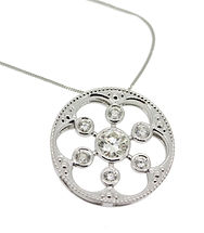 DIAMOND AND 18CT WHITE GOLD STAR BURST PENDENT. FREE FLOWING