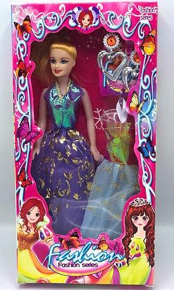 Muñeca en caja con vestidos Sebigus