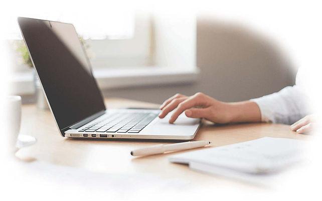 black-laptop-with-hand.jpg