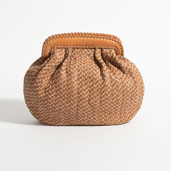 The Intricately hand Woven clutch