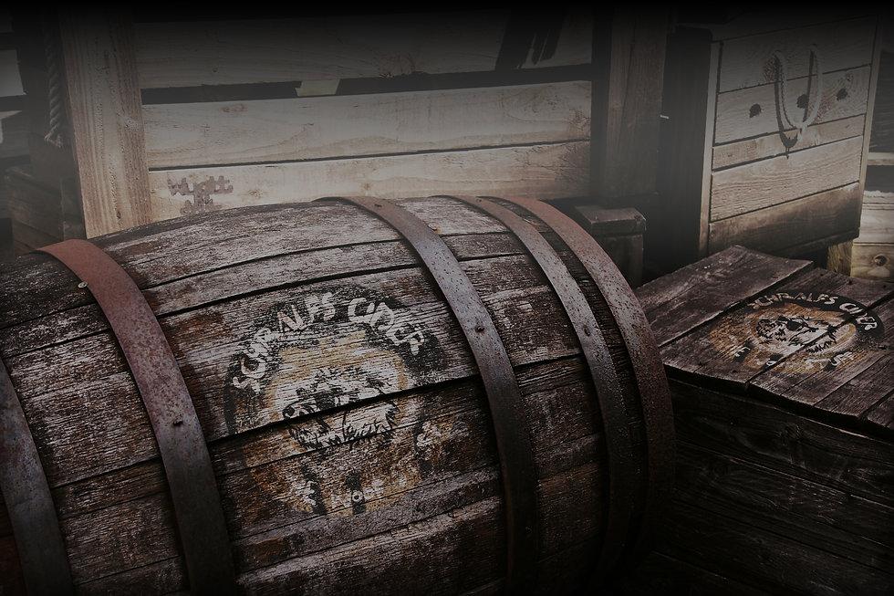 Schralfs Cider Logo on wooden barrels