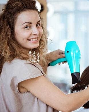 female-hairdresser-smiling-making-hairst