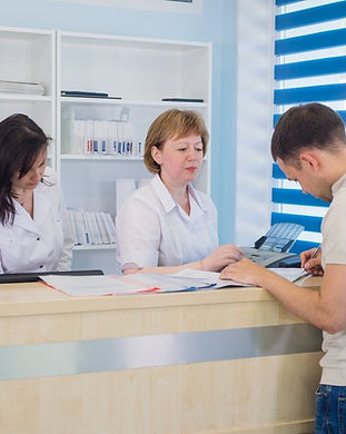 male-patient-with-doctor-nurse-reception