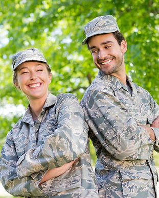 military-couple-standing-with-arms-cross