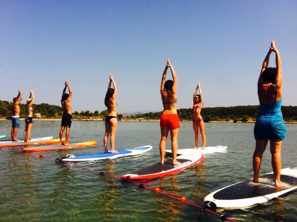 Cours collectif de Yoga sur Paddle