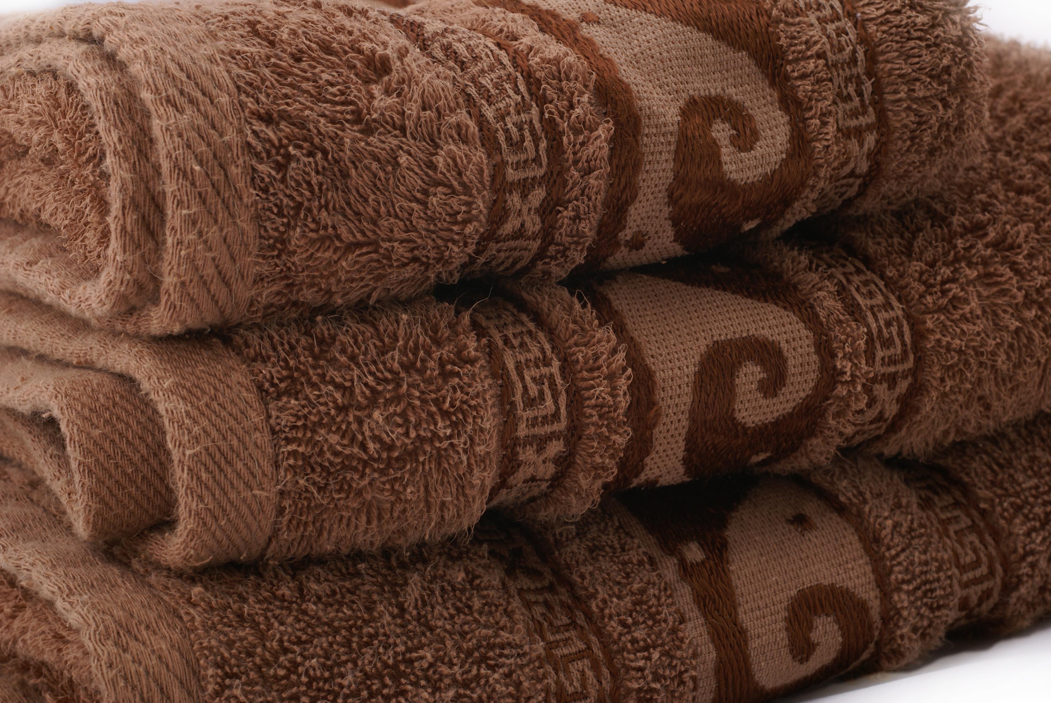 Luxury woven border towel.
