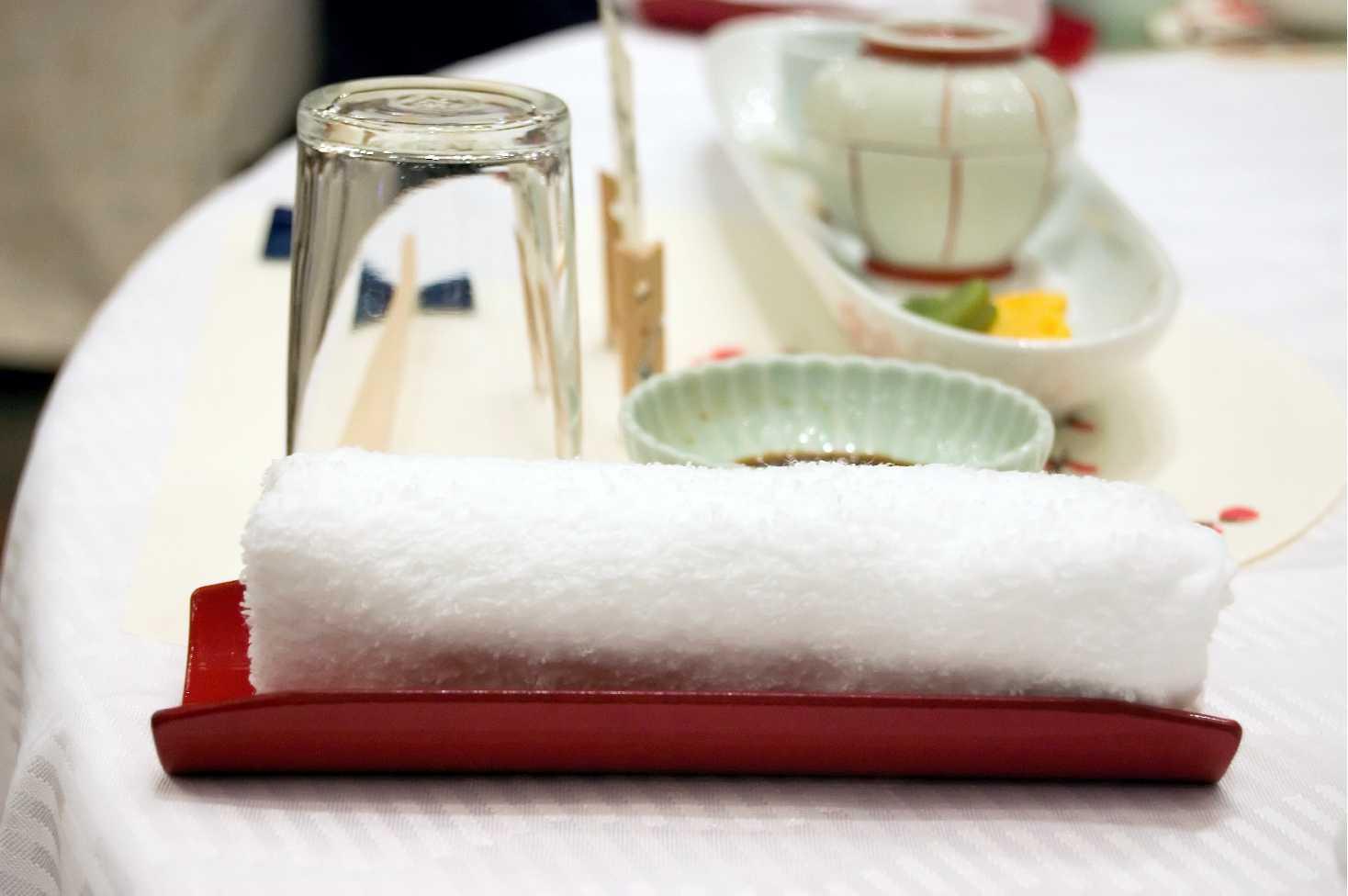 Oshibori hospitality towel.