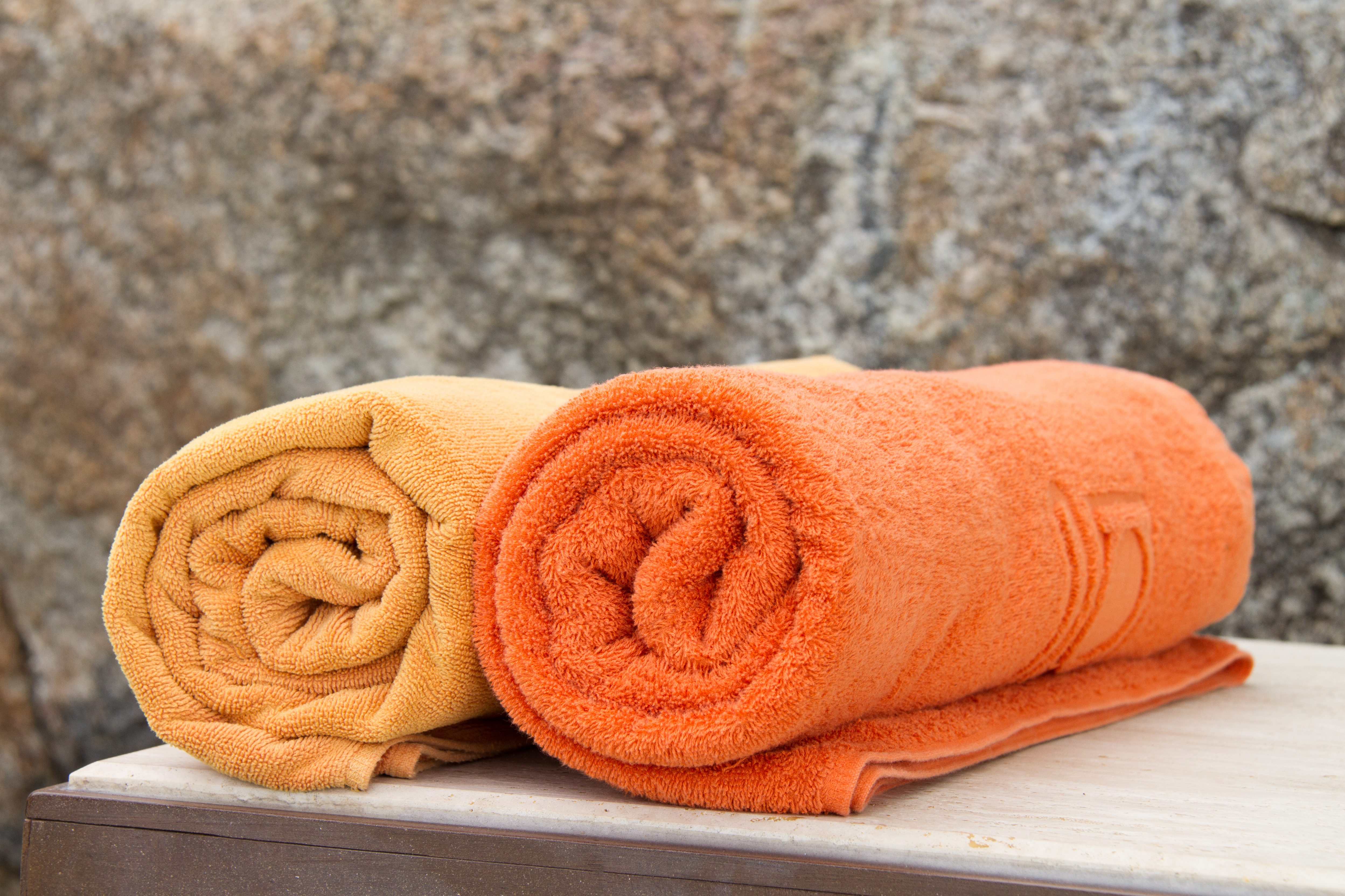 Dyed towel with relief woven design.