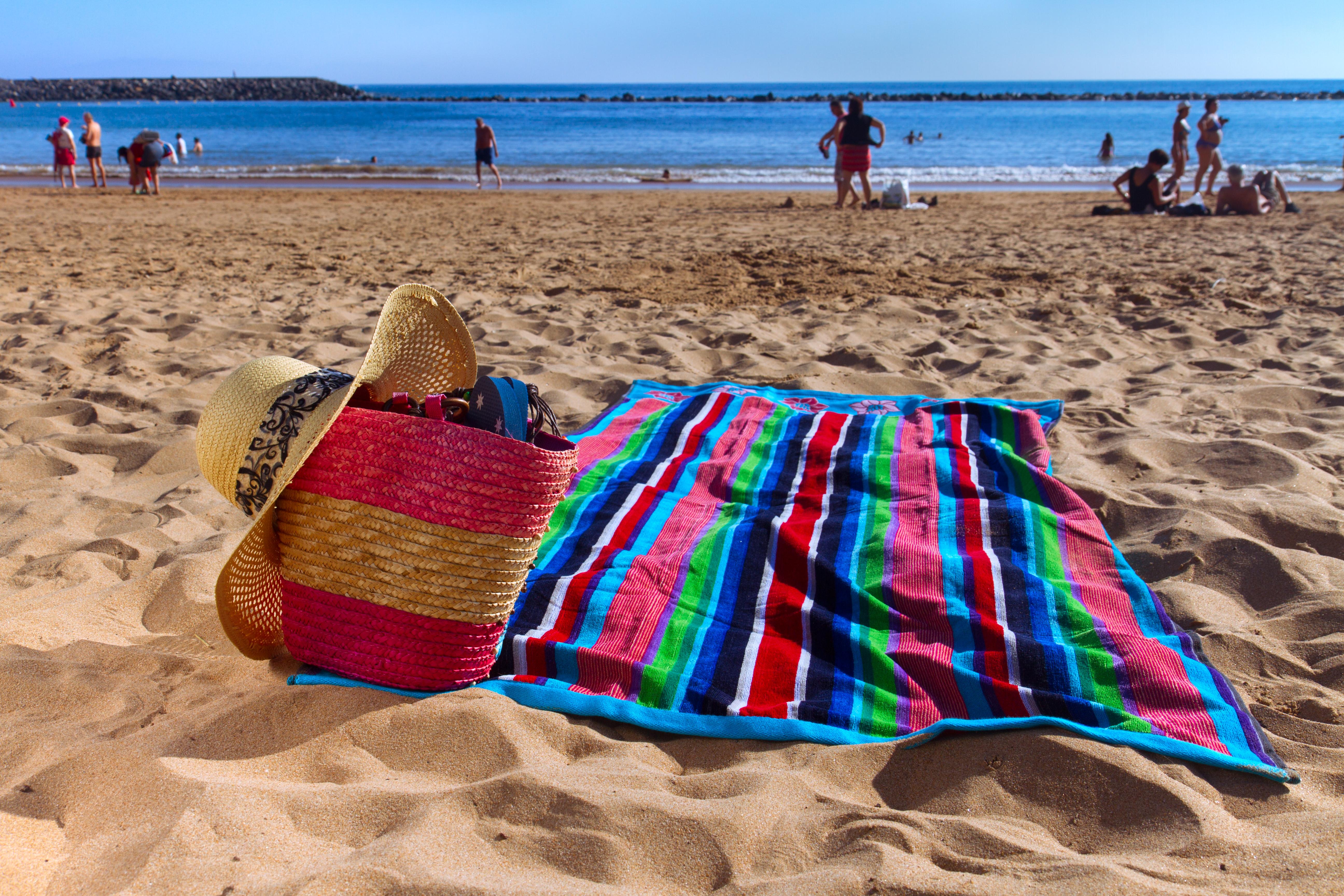 Multi colour jacquard woven velour beach towel.